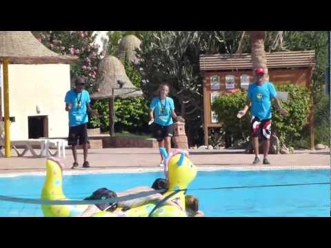 Park inn's animation team dancing to La bomba by the pool
